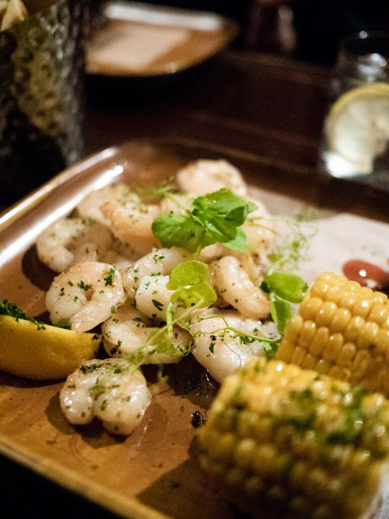 Garlic prawns and corn on the cob